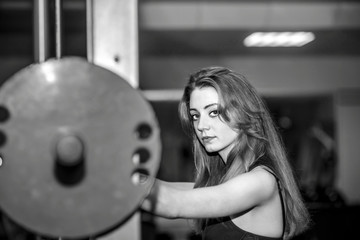 Young pretty girl work out in the gym
