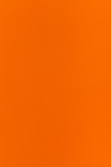 orange colored vertical sheet of paper