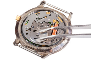 replacing battery in quartz watch isolated