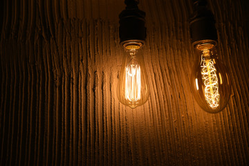 Vintage Edison Type Bulbs on Concrete Background
