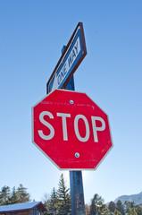 stop sign, blue sky