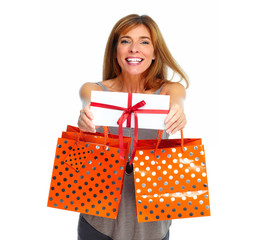 Shopping woman with envelope and gifts.