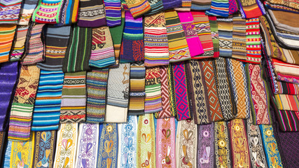 Woolen colored fabrics at the Andean market of Cusco, Peru