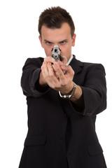 Young man pointing a gun