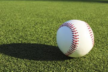 Baseball ball and the ground