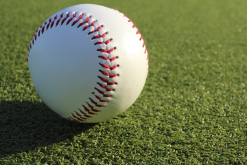 Baseball ball and the ground