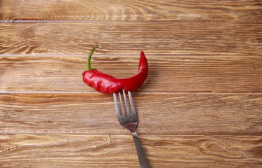 Chilli peppers and wood texture , background.