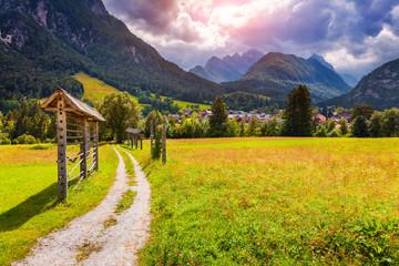 Summer sunny scene of Triglav mountain range
