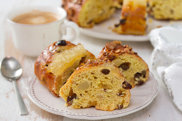 Christmas portuguese cake with dry fruits on white plate with cup of coffee