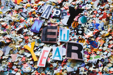 confetti on the table and alphabet letters that make up the best wishes for a happy new year