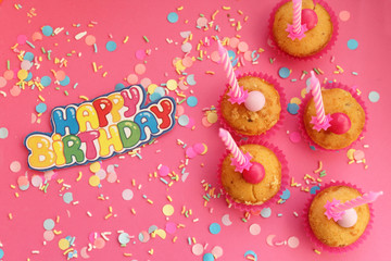 Cupcakes on pink background - happy birthday card