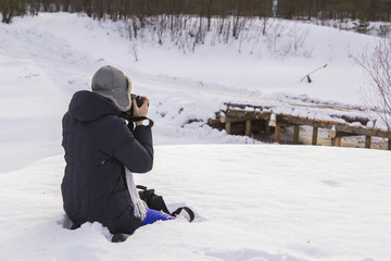 Background winter landscape girl in the snow photographing nature winter day