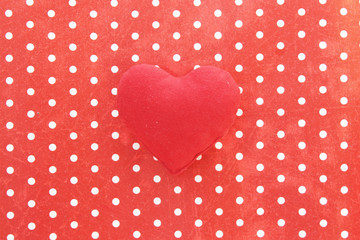 Red heart on polka dot background