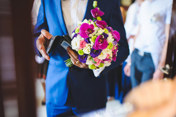 Groom with Flowers and Wallet