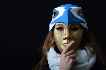 the girl with a theatrical mask