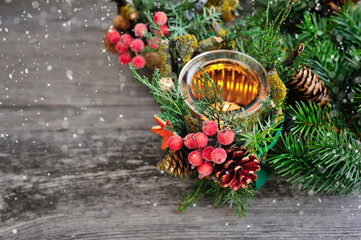 Candlestick and Christmas tree branches on a wooden table. Natural Christmas Decor