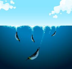 Penguins swimming under the ocean