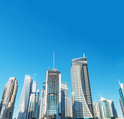 Dubai Marina skyline. Beautiful buildings under a blue sky