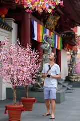 Tourist outside chinese temple