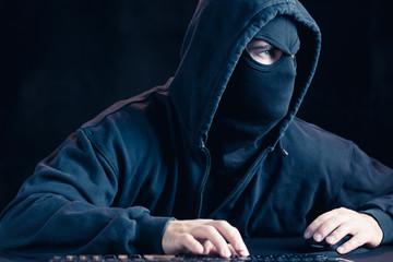 Cyber terrorist in black mask