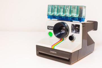 Classic instant film camera with genuine flash