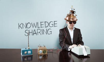 Knowledge is sharing concept with vintage businessman and calculator