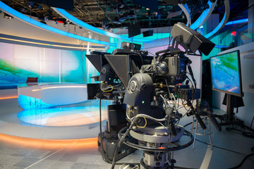 TV NEWS cast studio with camera and lights.