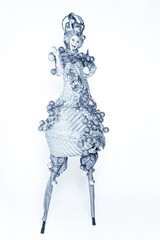 A woman dressed in  luxury  carnival costume silver light bulb on white backgr