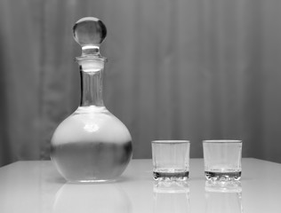 decanter and two glasses with vodka standing on table