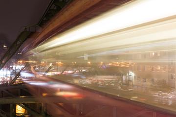 schwebebahn train wuppertal germany speed blur in the evening