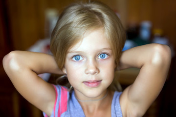 Portrait of attractive young blonde girl
