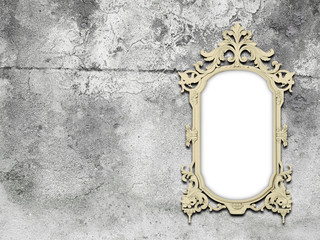 One golden baroque frame on grey weathered concrete wall background