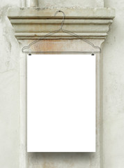 One vertical sheet frame with clothes hanger on ancient stone capital background