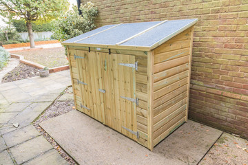 New tool shed in a garden.
