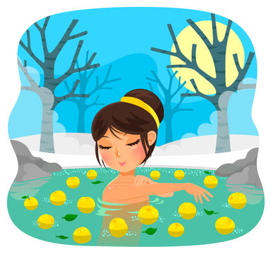 girl taking a bath with yuzu fruit (tradition during the Japanese holiday of winter solstice)