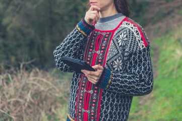 Woman using tablet in nature