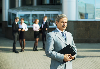 a successful businessman with documents on the background of the