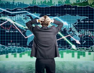 Businessman grabs the head concept with business chart on scoreb
