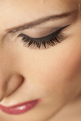 closeup of made-up female eye with artificial eyelashes