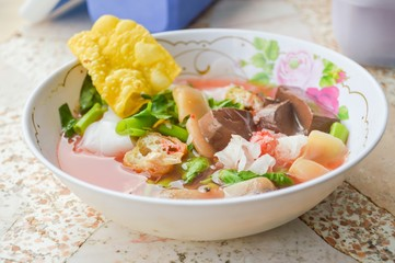 pink seafood flat noodles Yen ta fo - Thailand healthy food