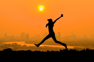silhouette of woman jumping when happy