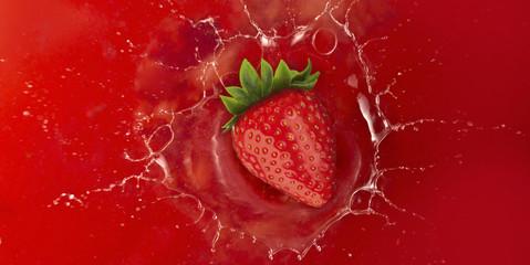 strawberry splash into red juice liquid
