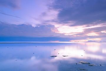 Dramatic rain cloud,sea and sky at dusk.Long exposure technique