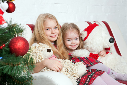 Two sisters with teddy bears. Winter holidays.