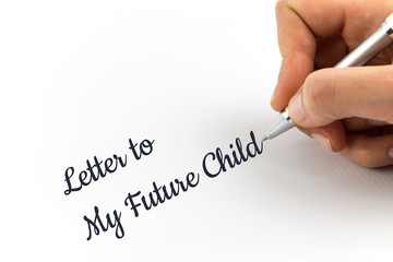 "Hand writing ""Letter to My Future Child"" on white sheet of paper."