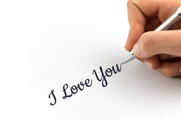 "Hand writing ""I Love You"" on white sheet of paper."