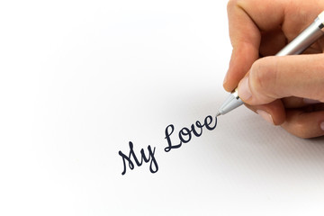"Hand writing ""My Love"" on white sheet of paper."