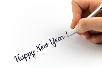 "Hand writing ""Happy New Year!""  on white sheet of paper."