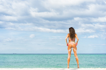 Young beautiful woman posing alone on the beach