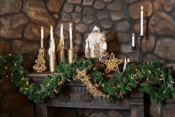 the candles on the fireplace with Santa Claus